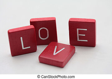 """Love letters - Red wooden letters, spelling the word """"love"""""""
