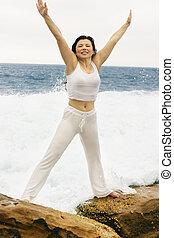 love Life - Woman on wave swept rocks