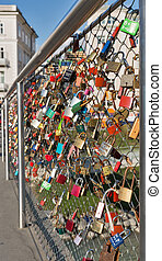 Bridge with love locks and Salzach river in in Salzburg, Austria.