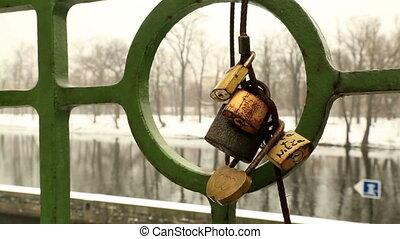 Love locks on the bridge railing - Love locks at bridge in...