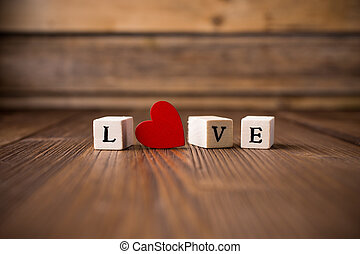 Love. - Love message written in wooden blocks. Red heart.