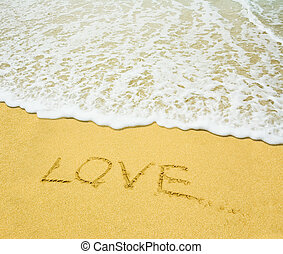 "love - ""Love"" written in the sandy beach"