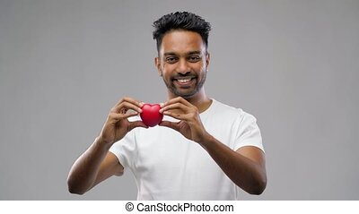 indian man with red heart over grey background - love,...