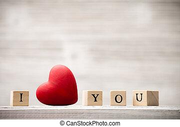 Love message. - Love message written in wooden blocks.
