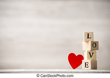 Love message. - Love message written in wooden blocks.