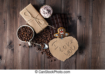 Love message on table with roasted coffee beans