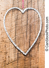 white shape of a heart on a wooden ground