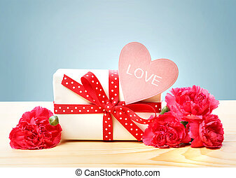 Love message with gift box and carnations