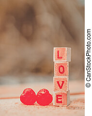 Love message written in wooden blocks.