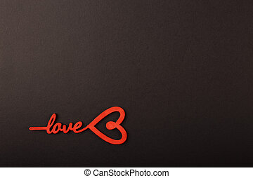 Love message written on black background.