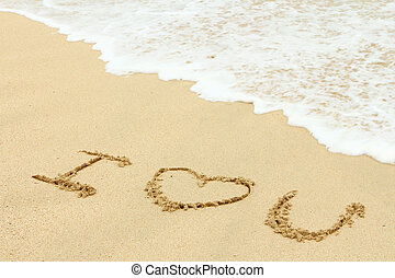 Love message written on the sand