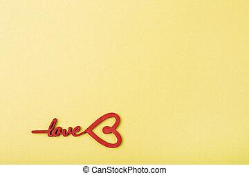 Love message written on yellow background.