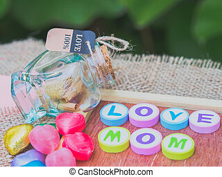 love mom spelled with colorful alphabet blocks