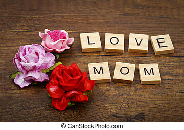 Love mom wording with rose flowers mother's day concept.
