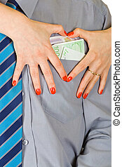 Love of money - Beautiful woman hands shaping heart form...