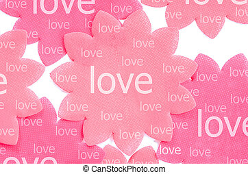 Love on pink paper flower.