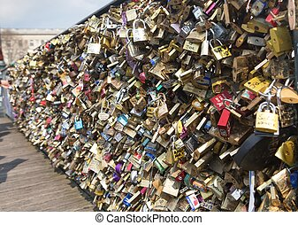 Love padlocks on Bridge of arts in Paris, France