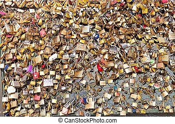 Love padlocks on Bridge of arts in Paris