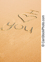 """Love phrase written in the sand - The words \""""I love you\""""..."""