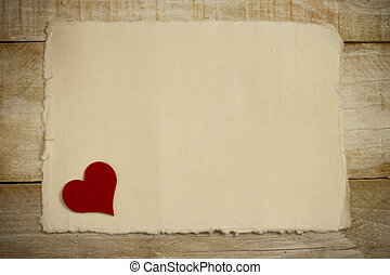love - red heart over old paper background