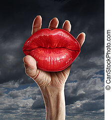 Romantic love possession in a passion relationship concept with a male hand holding red ruby red female lips as a metaphor for learning to let go emotional prison and psychological confinement.