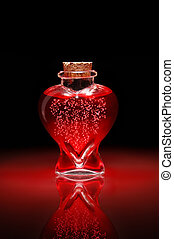 Love Potion #9 - Bottle of love potion shaped like a heart...
