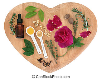 Love potion ingredients on a heart shaped wooden board over white background.