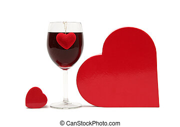 Red heart and glass of wine on a white background