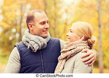 smiling couple in autumn park