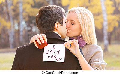 Love, relationships, engagement and wedding concept - man proposing ring woman outdoors