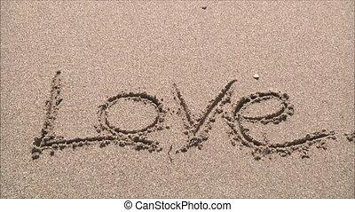 """love"", słowo, piasek"