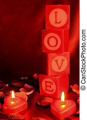 "Love shrine - The word ""LOVE"" spelt out on candles, with two..."