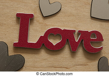 Love sign on wooden background