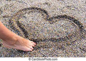 Love Sign - Young Girl Drawing A Heart In The Sand With Her...