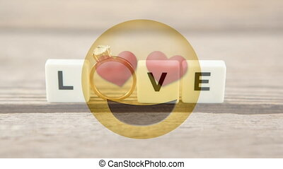 Love smiley with hearts and tiles spelling love with engagement ring for valentine day