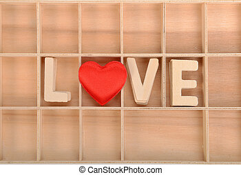 love spell with Wooden alphabet blocks