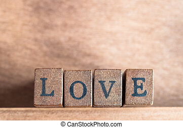 Love Spelled Out - The word 'Love' spelled out on a row of ...