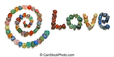 A Spiral and the word 'LOVE' formed from tumbled precious stones