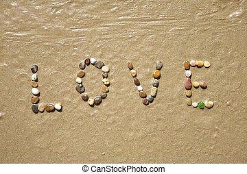 Love stones on sand beach