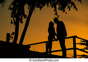 Love story. Couple on the sunset. Silhouette of Lovers