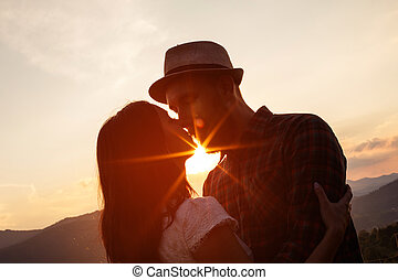 Love story. silhouettes of Couple on the sunset. s