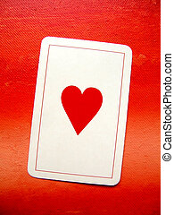 Love symbol - Card with red heart on a red painted...