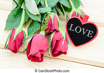 Love text in wooden tag.