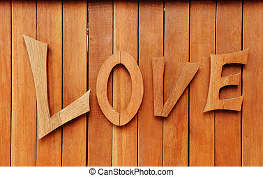 Love text on wooden background