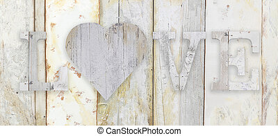 love text with heart shape on wood planks grunge texture background
