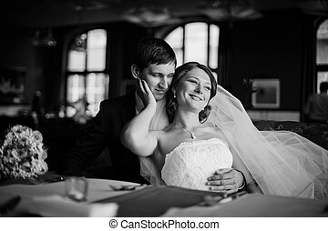 love the elegant young couple tenderly embracing