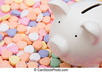 Piggy bank on candy hearts � love to save money
