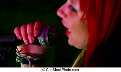 Love to sing on stage - Beautiful girl with multicolored...