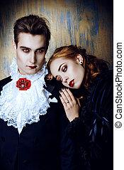love to vampire - Beautiful couple of vampires dressed in...