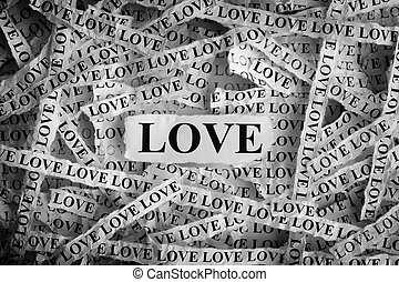 Torn pieces of paper with the word Love